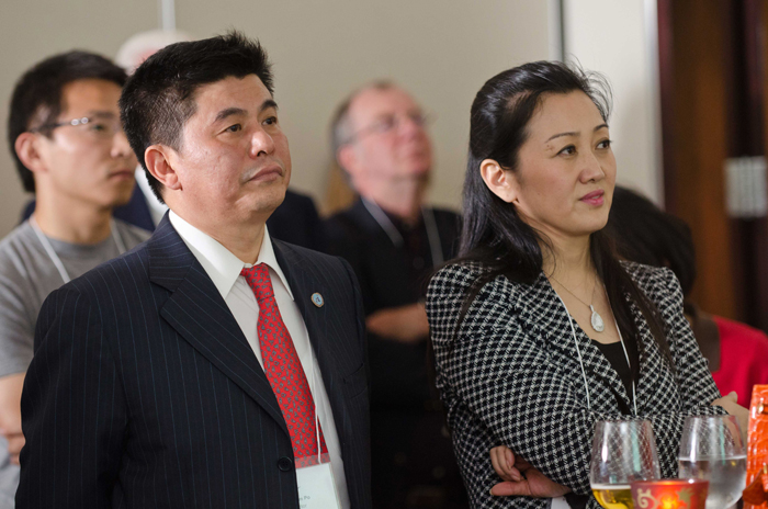 Linda Lam Kwan, Interim President and CEO, and Yan Kim Po, Chairman of the Board, attentively listen to a presentation about Adex (June 2011).