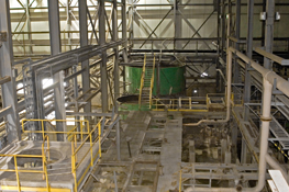 Inside of the Mount Pleasant mill, showing the (green) tungsten thickener tank in the flotation area.