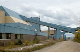 Galleries between the conveyor decline (hidden on right), oarse-ore storage building (on left), and crusher house (in middle), Mount Pleasant mine.