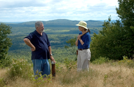 Adex mine site manager Roger Young (left) and visiting geologist beside a collared drillhole from the mid-2008 drilling program at the Fire Tower Zone, Mount Pleasant.
